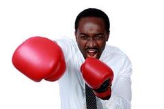 Сердитый бизнесмен готовый для того чтобы пробить вас Стоковое Изображение