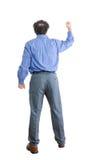 Сердитый бизнесмен смотря на ОН назад против белизны Стоковое Фото