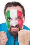 Сердитый вентилятор от Италии показывая его кулаки Стоковые Фото