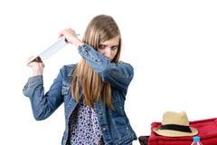 Сердитый подросток с таблеткой Стоковые Изображения