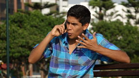 Сердитый предназначенный для подростков телефонный звонок мальчика Стоковая Фотография