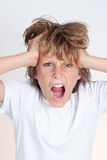 Сердитый разочарованный предназначенный для подростков мальчик Стоковое фото RF