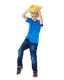 Сердитый ребенк держа книги Стоковые Изображения