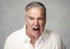 Сердитый старший человек стоковое фото
