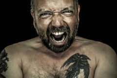 Сердитый человек с бородой Стоковая Фотография RF