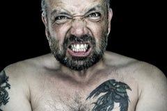 Сердитый человек с бородой стоковые фотографии rf