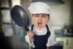 Сердитый шеф-повар девушки Стоковые Фото