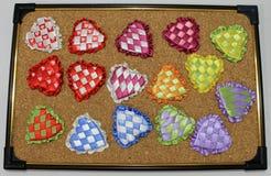 Сердца лент сатинировки пестротканых на день ` s валентинки Стоковые Изображения RF