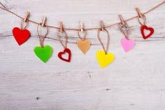 Сердца и зажимки для белья на веревочке Стоковые Изображения RF