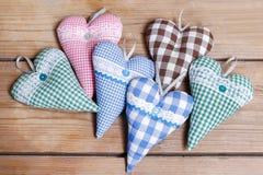 Сердца на деревянной предпосылке Стоковое Изображение
