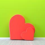 Сердца над зеленой стеной Стоковая Фотография