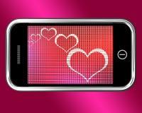 Сердца на мобильном телефоне показывают влюбленность и онлайн датировка бесплатная иллюстрация