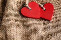 Сердца на предпосылке холста Стоковые Фото