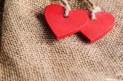 Сердца на предпосылке холста Стоковые Фотографии RF