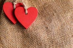 Сердца на предпосылке холста Стоковая Фотография RF