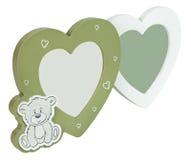 Сердца рамки фото младенца на isolaed белой предпосылке Стоковые Фото