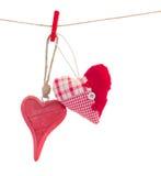 2 сердца связанных смертной казни через повешение красных на белизне Стоковые Фотографии RF