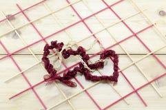 2 сердца сделали наш красного шнурка Стоковая Фотография
