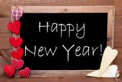 Сердца Chalkbord, красных и желтых, отправляют СМС счастливый Новый Год Стоковое Фото