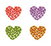 Сердца coloful изолированных пилюлек Стоковое Фото