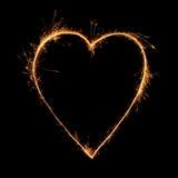 Сердце бенгальского огня на черной предпосылке Стоковое фото RF