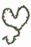 Сердце венка рождества с красными маленькими колоколами стоковые фото