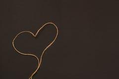 Сердце веревочки на черной предпосылке Стоковое Фото
