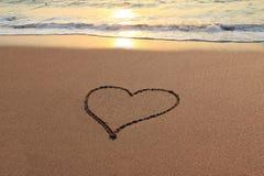 Сердце влюбленности на пляже Стоковые Изображения RF