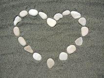 Сердце выровняно с камнями Стоковые Изображения