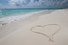 Сердце в песке Стоковые Изображения