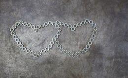 Сердце 2 гаек на предпосылке металла Сердце гайки для valent Стоковые Изображения RF