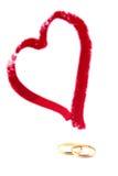 Сердце и обручальные кольца Стоковая Фотография