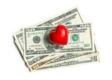 Сердце камня на американских долларах Стоковые Фотографии RF