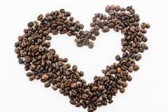 Сердце кофейных зерен на белой предпосылке Стоковые Фотографии RF