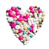 Сердце красочных пилюлек Стоковое Изображение