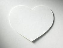 Сердце на бумажной предпосылке Стоковая Фотография