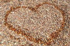 Сердце на камнях Стоковые Изображения