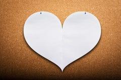 Сердце на предпосылке пробочки стоковые изображения