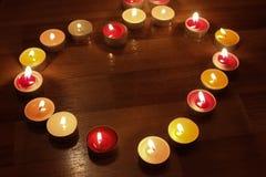Сердце от горящих свечей Стоковое Изображение