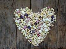 Сердце от фасолей различных разнообразий и цветов Стоковые Фото