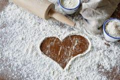 Сердце почищенное щеткой в сцене выпечки Стоковые Изображения