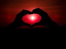 сердце рук делает форму Стоковые Изображения RF