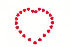 Сердце сформированное из акриловых красных сердец Стоковое фото RF