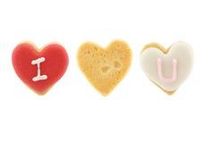 Сердце сформировало печенья (я тебя люблю) на белой предпосылке Стоковые Изображения