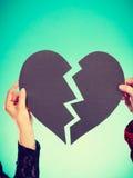Сердце 2 людей фиксируя Стоковая Фотография