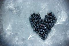 Сердце ягод, голубое сердце голубики, влюбленность и здоровье жульничают Стоковые Изображения RF
