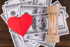Сердце, sandglass & банкноты Стоковые Изображения RF