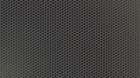 Сетка металла конспекта сияющая шестиугольная в темной предпосылке стоковое фото