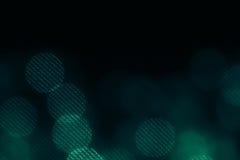 Сетка Bokeh темная ая-зелен объезжает на черной предпосылке Стоковые Фото