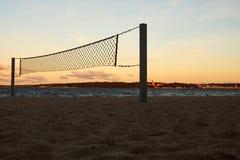 Сеть на пляже на заходе солнца Стоковое Фото